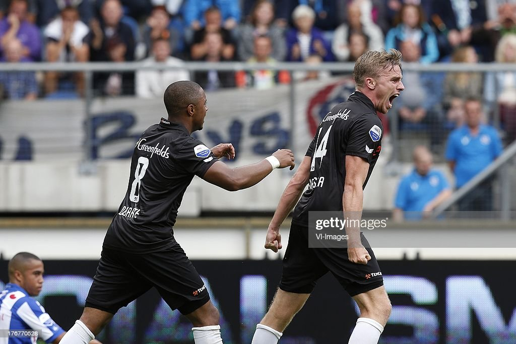 Lerin Duarte of Heracles Almelo (L), Ben Rienstra of Heracles Almelo (R) during the Dutch Eredivisie match between sc Heerenveen and Heracles Almelo on August 18, 2013 at the Abe Lenstra stadium in Heerenveen, The Netherlands.