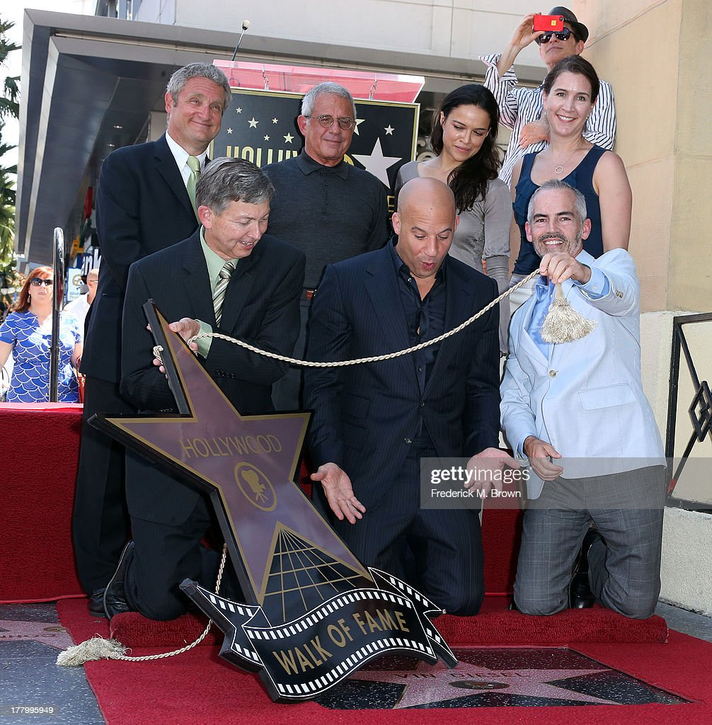 Hollywood Chamber of Commerce/President, actor Vin Diesel, guests, Ron Meyer, President/COO, Universal Studios, actress Michelle Rodriguez and a guest pose during ceremony honoring actor Vin Diesel on The Hollywood Walk of Fame on August 26, 2013 in Hollywood, California.