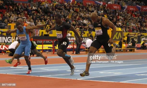 Lerone Clarke dips on the line to beat Nesta Carter and Asafa Powell in the Mens 60metre final during the Aviva Grand Prix at the National Indoor...