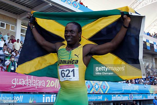 Lerone Clarke of Jamaica reacts after winning the gold medal in the men's 100m final during Day 11 of the XVI Pan American Games at Telmex Stadium on...