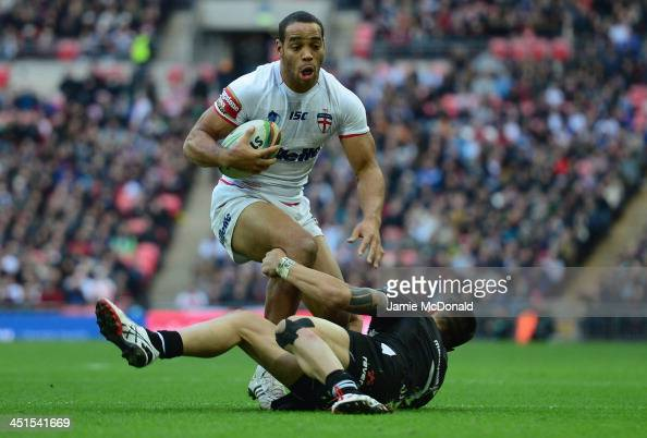 Leroy Cudjoe of England is tackled by Shaun Johnson of New Zealand during the Rugby League World Cup Semi Final match between New Zealand and England...