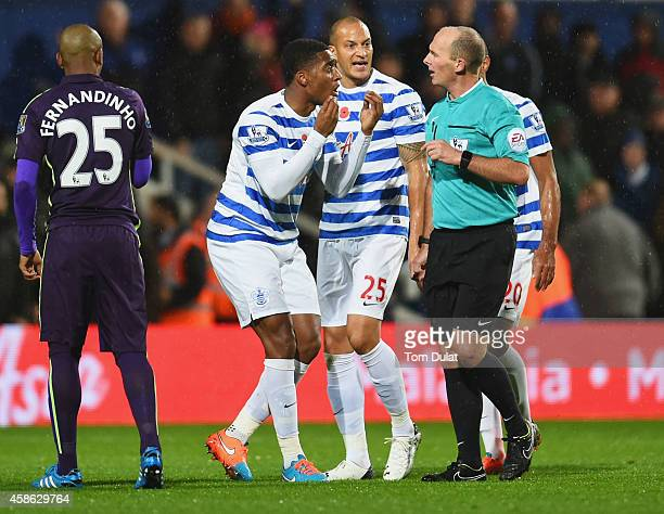 Leroy Fer Bobby Zamora and Karl Henry of QPR protest to referee Mike Dean as Charlie Austin's goal is disallowed during the Barclays Premier League...