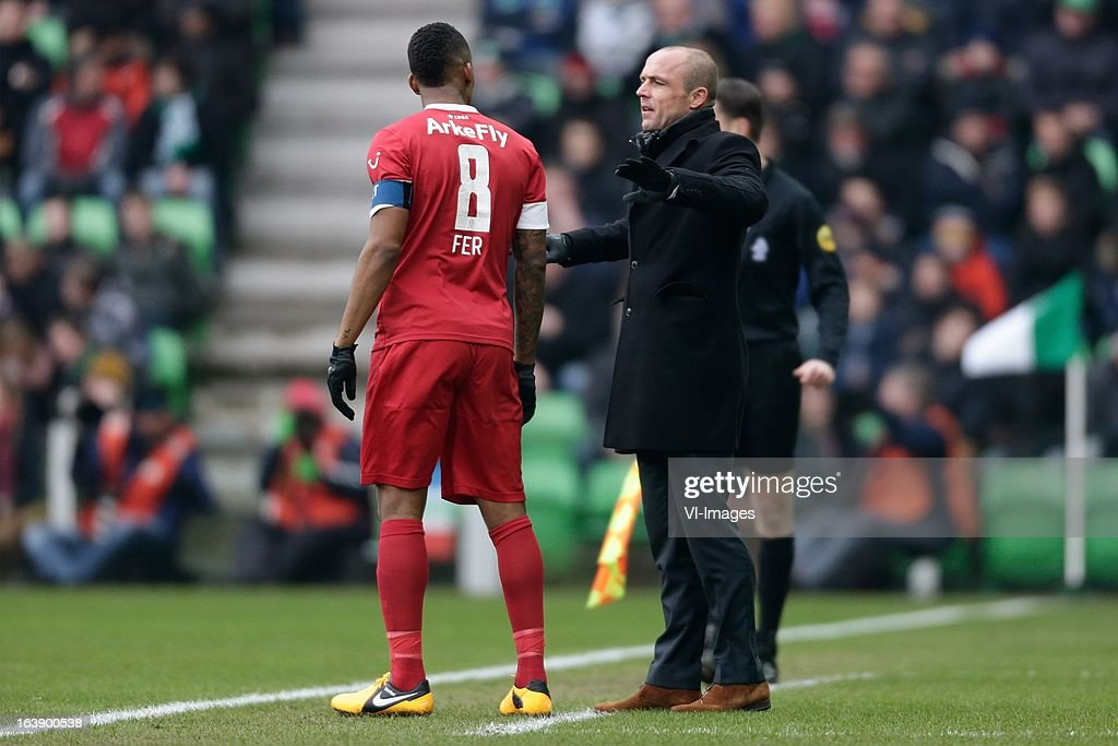 Leroy Fer (L) coach Alfred Schreuder (R) of FC Twente during the Dutch Eredivisie match between FC Groningen and FC Twente at the Euroborg Stadium on march 17, 2013 in Groningen, The Netherlands