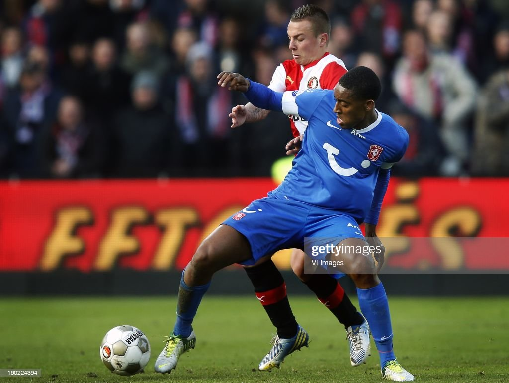 Leroy Fer of FC Twente (R), Jordy Clasie of Feyenoord (L) during the Dutch Eredivise match between Feyenoord and FC Twente at stadium De Kuip on January 27, 2013 in Rotterdam, The Netherlands.
