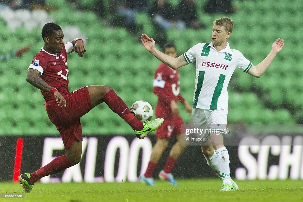Leroy Fer of FC Twente, Michael de Leeuw of FC Groningen during the Eredivisie Europa League Playoff match between FC Groningen and FC Twente on May 16, 2013 at the Euroborg stadium at Groningen, The Netherlands.