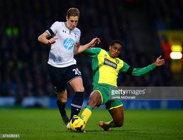 Leroy Fer of Norwich City tackles Michael Dawson of Tottenham Hotspur during the Barclays Premier League match between Norwich City and Tottenham...