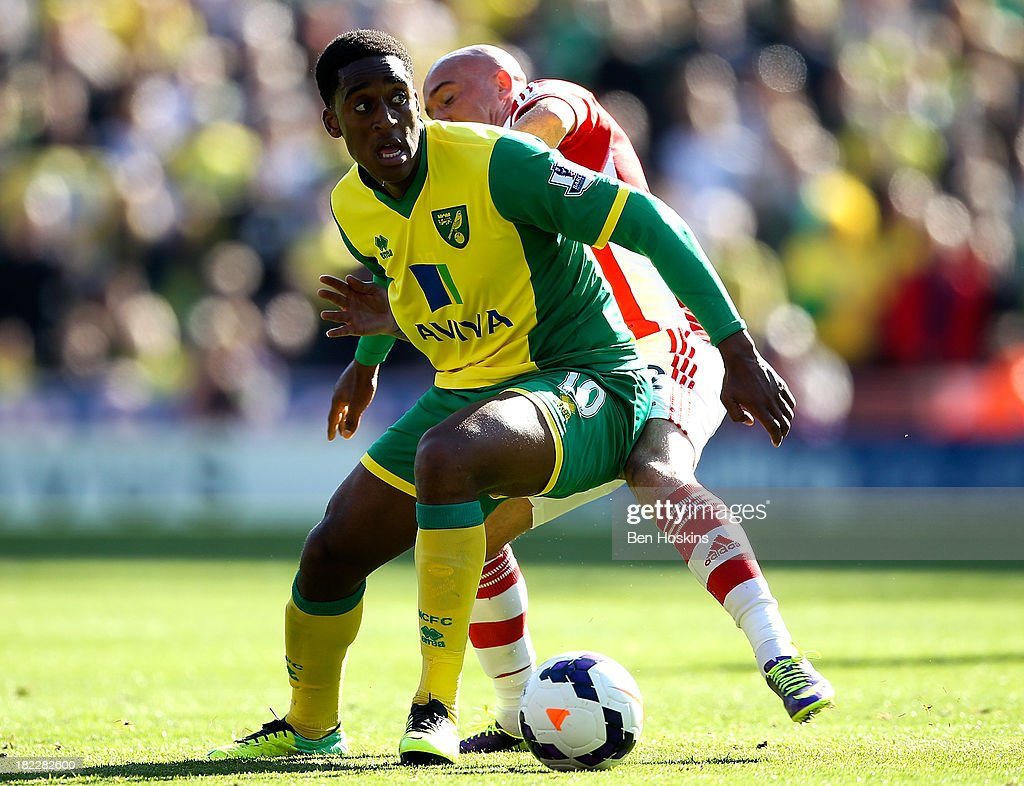 Leroy Fer of Norwich holds off the challenge of Stephen Ireland of Stoke during the Barclays Premier League match between Stoke City and Norwich City at the Britannia Stadium on September 29, 2013 in Stoke on Trent, England.