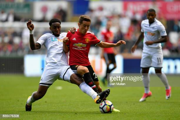 Leroy Fer of Swansea City and Ander Herrera of Manchester United battle for possession during the Premier League match between Swansea City and...