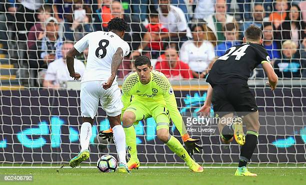 Leroy Fer of Swansea City beats goalkeeper Thibaut Courtois and Gary Cahill of Chelsea as he scores their second goal during the Premier League match...