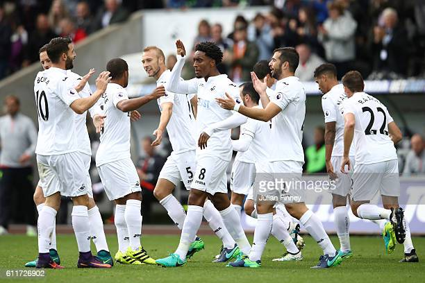 Leroy Fer of Swansea City celebrates scoring his sides first goal with his Swansea City team mates during the Premier League match between Swansea...