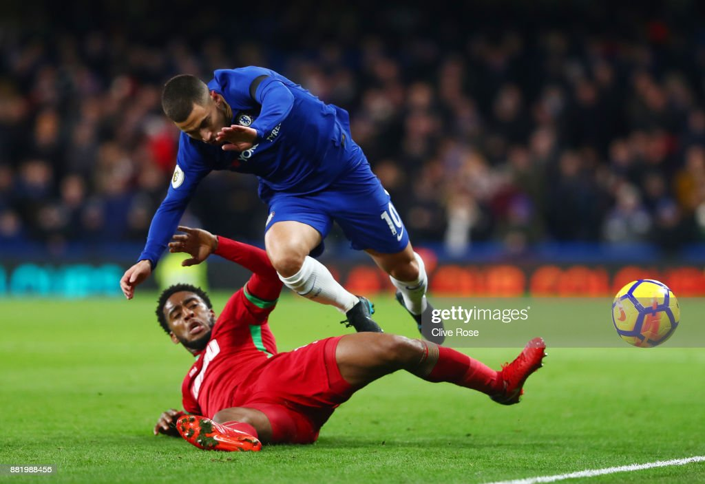 Leroy Fer of Swansea City fouls Eden Hazard of Chelsea during the Premier League match between Chelsea and Swansea City at Stamford Bridge on November 29, 2017 in London, England.