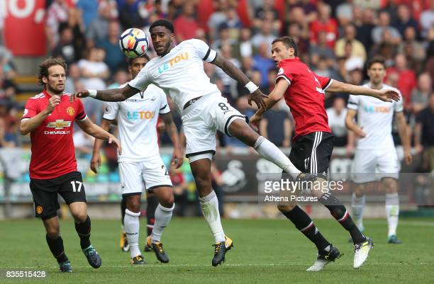 Leroy Fer of Swansea City is marked by Daley Blind of Manchester United and Nemanja Matic of Manchester United during the Premier League match...