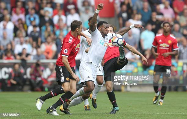 Leroy Fer of Swansea City is marked by Nemanja Matic of Manchester United during the Premier League match between Swansea City and Manchester United...