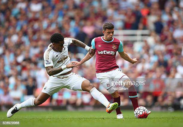 Leroy Fer of Swansea City tackles Aaron Cresswell of West Ham United during the Barclays Premier League match between West Ham United and Swansea...