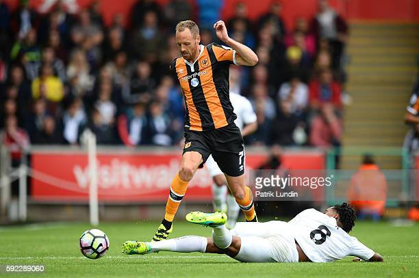 Leroy Fer of Swansea City tackles David Meyler of Hull City during the Premier League match between Swansea City and Hull City at Liberty Stadium on...