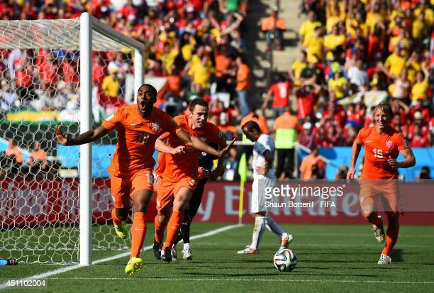 Leroy Fer of the Netherlands celebrates scoring his team's first goal during the 2014 FIFA World Cup Brazil Group B match between Netherlands and...