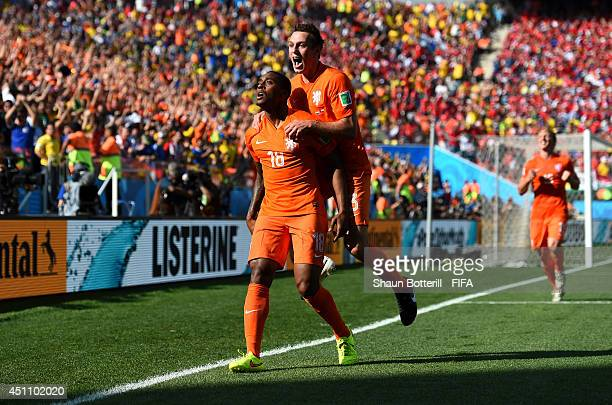 Leroy Fer of the Netherlands celebrates scoring his team's first goal with his teammate Stefan de Vrij during the 2014 FIFA World Cup Brazil Group B...