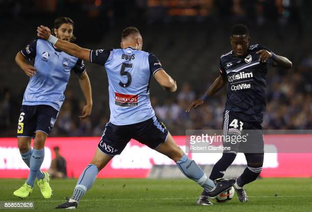 Leroy George of the Victory is challenged by Jordy Buijs of Sydney FC during the round one ALeague match between the Melbourne Victory and Sydney FC...