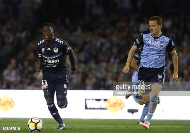Leroy George of the Victory is chased by Brandon O'Neill of Sydney FC during the round one ALeague match between the Melbourne Victory and Sydney FC...