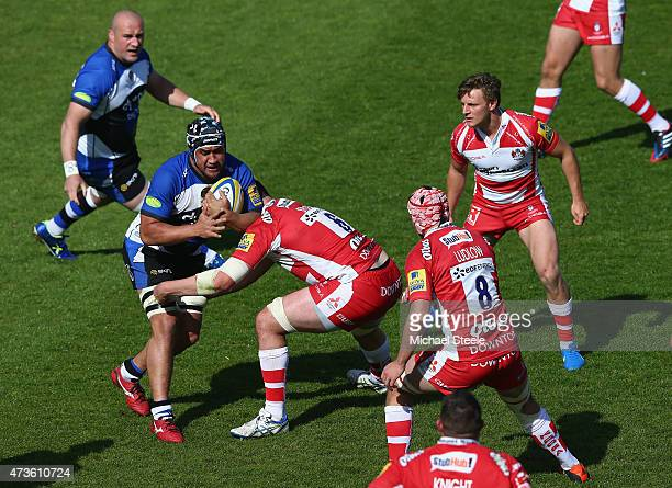 Leroy Houston of Bath is challenged by Elliott Stooke of Gloucester during the Aviva Premiership match between Bath Rugby and Gloucester Rugby at the...