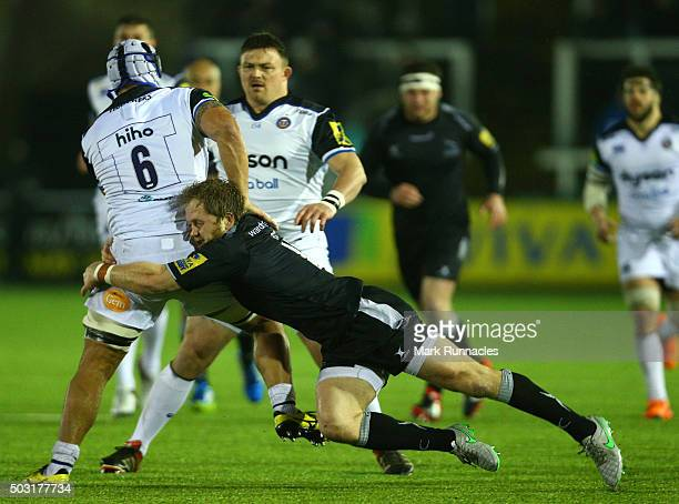 Leroy Houston of Bath Rugby is tackled by Alex Tait of Newcastle Falcons during the Aviva Premiership match between Newcastle Falcons and Bath Rugby...