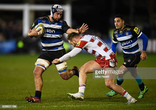 Leroy Houston of Bath Rugby is tackled by Bill Meakes of Gloucester Rugby during the Aviva Premiership match between Bath Rugby and Gloucester Rugby...