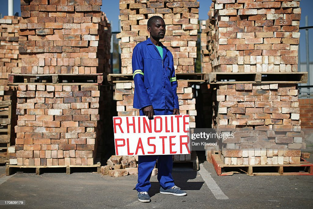 Leroy Mariegeve, 29 from Soweto, poses for a portrait while looking for work as a plasterer outside a building supplier on June 14, 2013 in Johannesburg, South Africa. Speaking of Nelson Mandela Mr Mariegeve said, 'He is a father figure of the nation, for whites, and for blacks'. The former South African President and leader of the anti-apartheid movement has spent over a week in hospital after being admitted for a recurring lung infection.