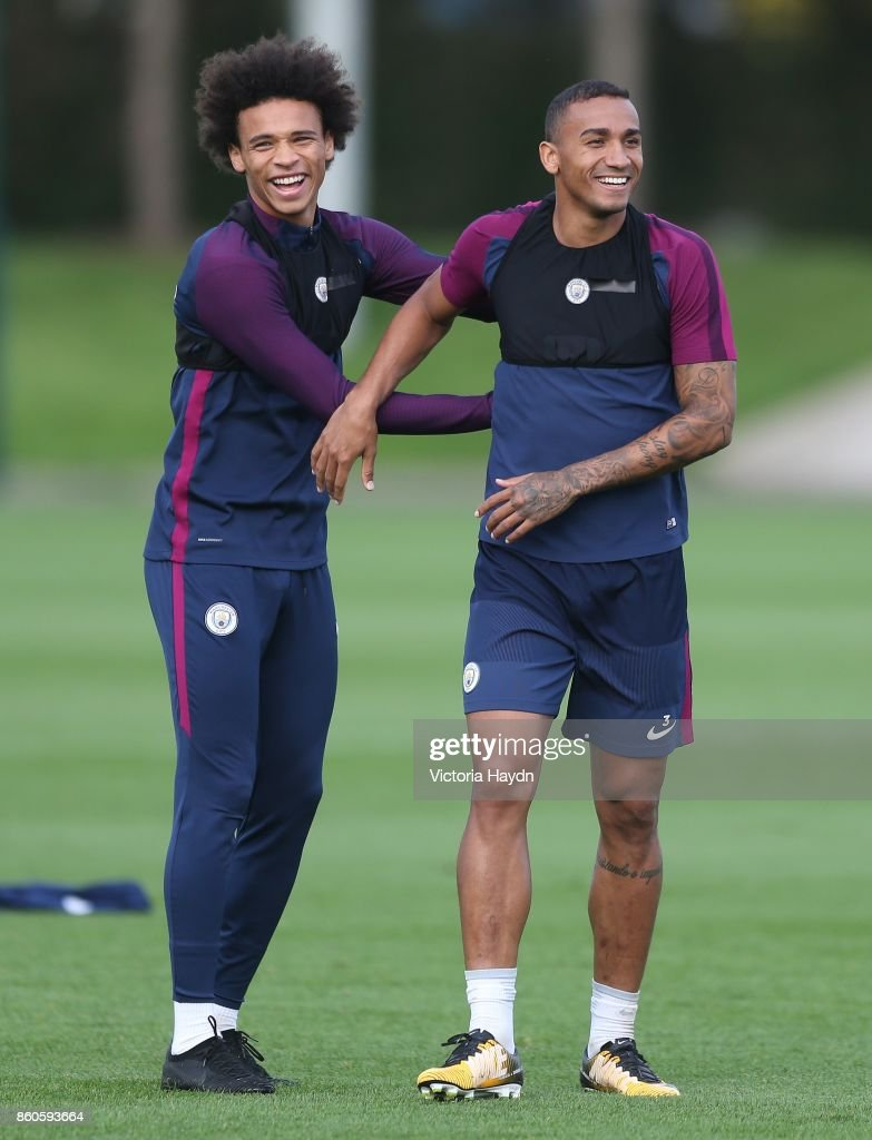 Leroy Sane and Danilo joke during training at Manchester City Football Academy on October 12, 2017 in Manchester, England.