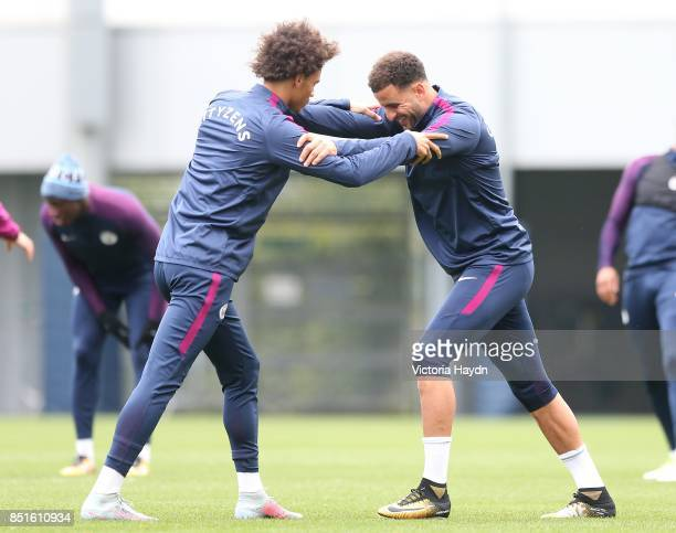 Leroy Sane and Kyle Walker during training at Manchester City Football Academy on September 22 2017 in Manchester England
