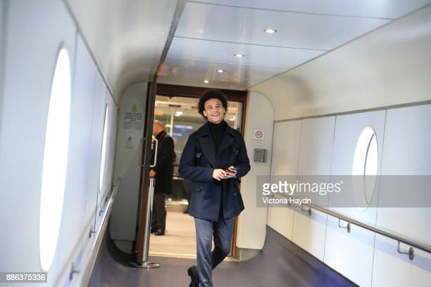 Leroy Sane boards the flight to Kharkiv to face Shakhtar Donetsk in the Champions League on December 4 2017 in Manchester England
