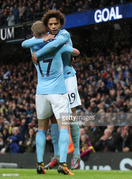 Leroy Sane celebrates scoring his side's third goal with Kevin De Bruyne during the Premier League match between Manchester City and Burnley at...