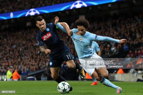 Leroy Sane is tackled by Christian Maggio during the UEFA Champions League group F match between Manchester City and SSC Napoli at Etihad Stadium on...