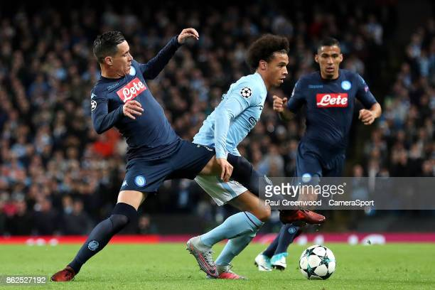 Leroy Sane is tackled by Jose Callejon during the UEFA Champions League group F match between Manchester City and SSC Napoli at Etihad Stadium on...