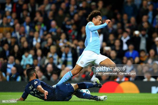 Leroy Sane is tackled by Raul Albiol during the UEFA Champions League group F match between Manchester City and SSC Napoli at Etihad Stadium on...
