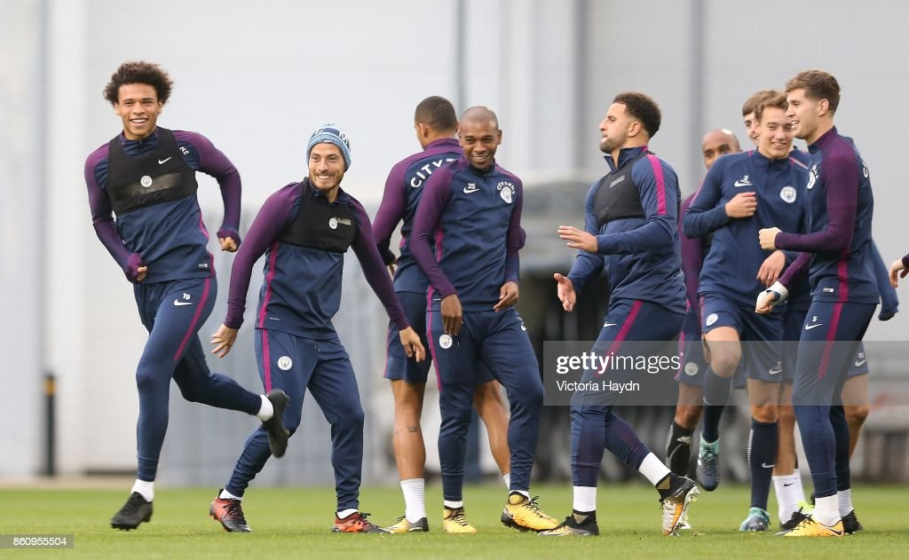 Leroy Sane jokes with teh squad during training at Manchester City Football Academy on October 13, 2017 in Manchester, England.
