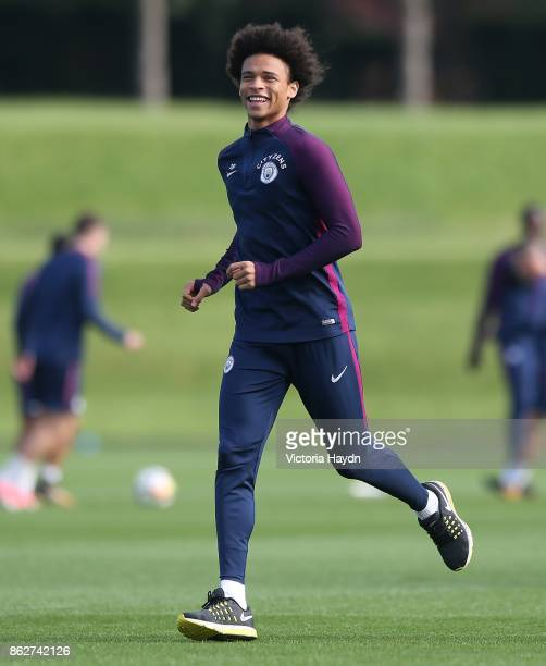 Leroy Sane laughs during training at Manchester City Football Academy on October 18 2017 in Manchester England