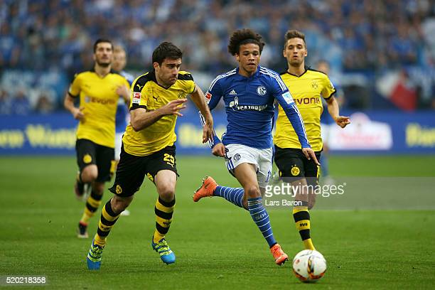 Leroy Sane of FC Schalke 04 battles for the ball with Sokratis Papastathopoulos of Borussia Dortmund during the Bundesliga match between FC Schalke...