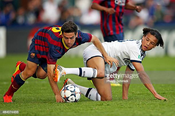 Leroy Sane of FC Schalke 04 fights for the ball with Jordi Ortega of FC Barcelona during the UEFA Youth League Semi Final match between Schalke 04...