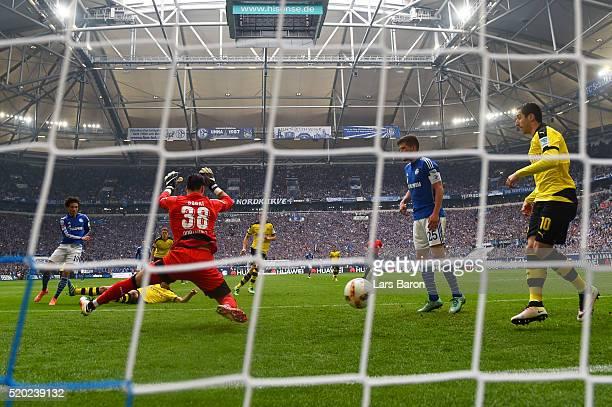 Leroy Sane of FC Schalke 04 scores his team's first goal during the Bundesliga match between FC Schalke 04 and Borussia Dortmund at VeltinsArena on...
