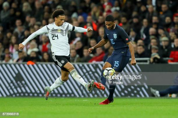 Leroy Sane of Germany and Joe Gomez of England battle for the ball during the international friendly match between England and Germany at Wembley...