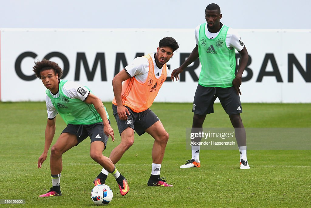 Leroy Sane (L) of Germany battles for the ball with his team mates <a gi-track='captionPersonalityLinkClicked' href=/galleries/search?phrase=Emre+Can&family=editorial&specificpeople=5909273 ng-click='$event.stopPropagation()'>Emre Can</a> (C) and Antonio Ruediger (R) during a training session at Stadio communale on day 8 of the German national team trainings camp on May 31, 2016 in Ascona, Switzerland.