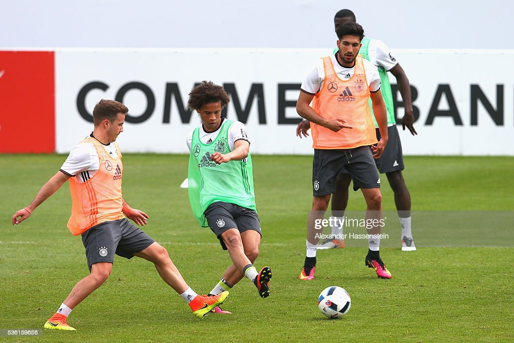 Leroy Sane (C) of Germany battles for the ball with his team mates <a gi-track='captionPersonalityLinkClicked' href=/galleries/search?phrase=Emre+Can&family=editorial&specificpeople=5909273 ng-click='$event.stopPropagation()'>Emre Can</a> (R) and <a gi-track='captionPersonalityLinkClicked' href=/galleries/search?phrase=Mario+Goetze&family=editorial&specificpeople=4251202 ng-click='$event.stopPropagation()'>Mario Goetze</a> (L) during a training session at Stadio communale on day 8 of the German national team trainings camp on May 31, 2016 in Ascona, Switzerland.