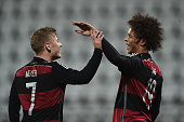 Leroy Sane of Germany celebrates with team mate Max Meyer as he scores the fifth goal during the 2017 UEFA European U21 Championships Qualifier...