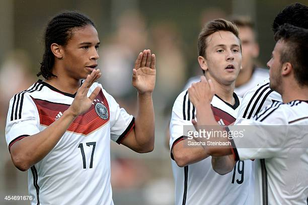 Leroy Sane of Germany celebrates with team mates after scoring his team's third goal during the international friendly match between U19 Germany and...