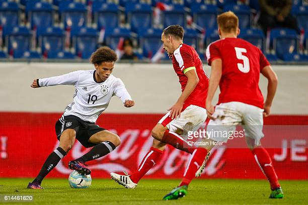 Leroy Sane of Germany challenges Dominik Wydra and Philipp Lienhart of Austria for the ball during the 2017 UEFA European U21 Championships Qualifier...