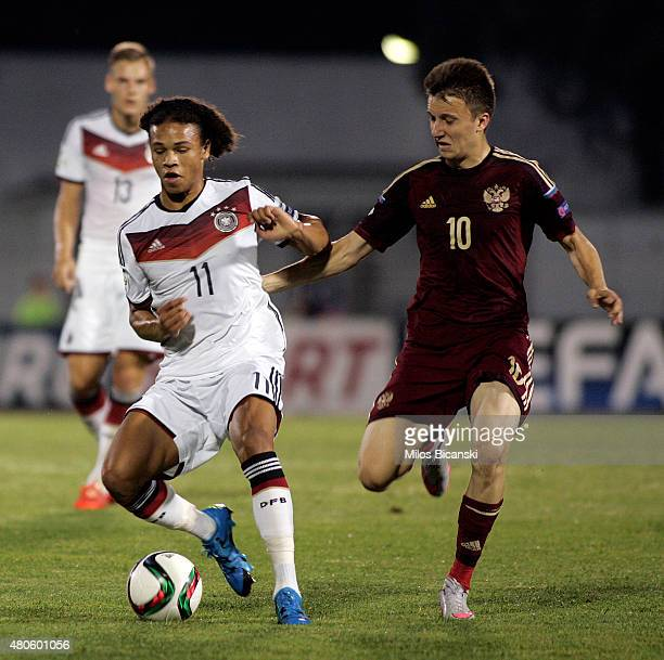 Leroy Sane of Germany competes with Aleksandr Golovin of Russia during the UEFA European Under19 Championship group stage match between U19 Russia...