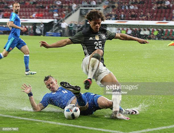 Leroy Sane of Germany fights for the ball with Jan Durica of Slovakia during the international friendly football match between Germany and Slovakia...