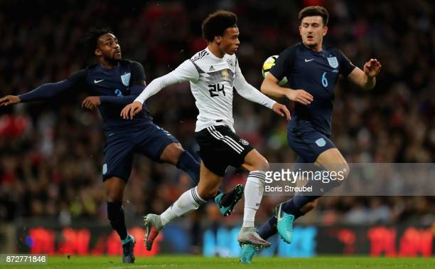 Leroy Sane of Germany is challenged by Danny Rose of England and Harry Maguire of England during the International friendly match between England and...
