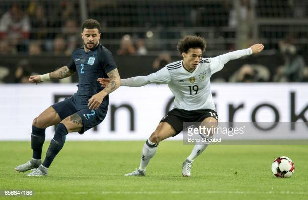 Leroy Sane of Germany is challenged by Kyle Walker of England during the international friendly match between Germany and England at Signal Iduna...