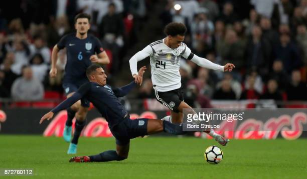 Leroy Sane of Germany is tackled by Jake Livermore of England during the International friendly match between England and Germany at Wembley Stadium...